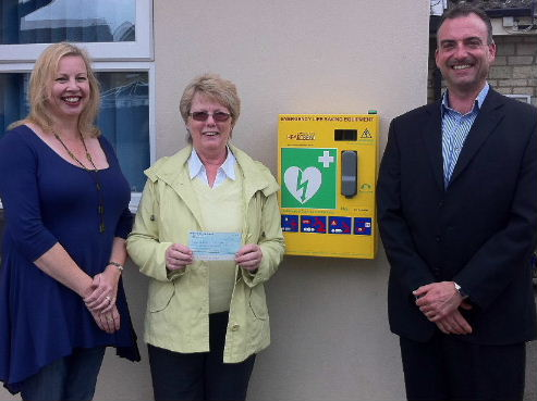 Mark Slatter presents a £500 cheque from Moto in the Community Trust, to Aril Balmforth & Linda Durno of KSM Community Defibrillator Scheme