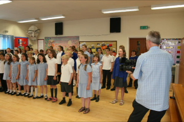 Filming the children singing