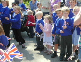 Children waiting to wave goodbye to the Duchess of Cornwall, 11th May 2009