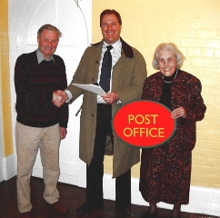 Signing the lease for the post office in 2004